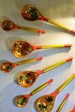 Vintage wooden spoons. Handmade copies Painted under the crest Gzhel and other old Russian painting stock images