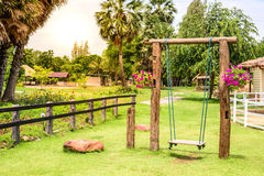 Vintage wooden swing in garden Royalty Free Stock Photos