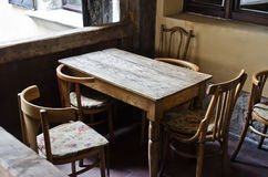 Vintage wooden table with chairs Stock Photos