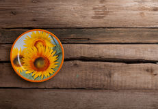 Vintage wooden table with rustic empty plate Royalty Free Stock Image