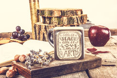 Vintage wooden table with tea cup and old book Stock Images