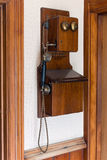 Vintage wooden telephone. Hung of a wall Stock Image