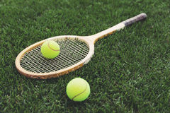 Vintage wooden tennis racket on grass Stock Photo