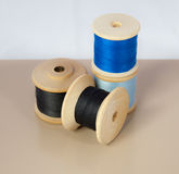 Vintage wooden thread spools Stock Photos