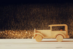 Vintage wooden toy car over wooden table Royalty Free Stock Image