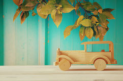 Vintage wooden toy car over wooden table Royalty Free Stock Images