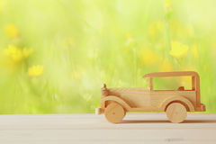 Vintage wooden toy car over wooden table Stock Photo