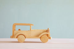 Vintage wooden toy car over wooden table Stock Images
