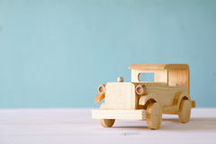 Vintage wooden toy car over wooden table. Nostalgia and simplicity concept. Vintage style image Stock Images