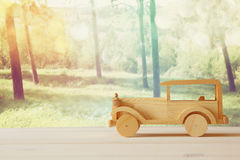 Vintage wooden toy car over wooden table Royalty Free Stock Photography