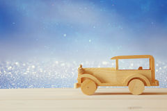 Vintage wooden toy car over wooden table Royalty Free Stock Photos