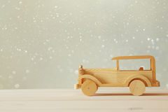 Vintage wooden toy car over wooden table. Royalty Free Stock Photo