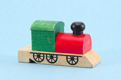 Wooden train locomotive toy on azure background Stock Photography