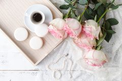 Vintage wooden tray with porcelain teacup and pink flowers royalty free stock photos