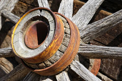Vintage Wooden Wagon Wheel. Closeup on the hub and spokes of an authentic vintage wooden wagon wheel like the kind used by pioneers to settle the American Old Royalty Free Stock Photo