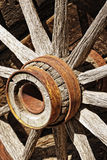 Vintage Wooden Wagon Wheel. Closeup on the hub and spokes of an authentic vintage wooden wagon wheel like the kind used by pioneers to settle the American Old Stock Image