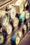 Vintage wooden wall with clocks. Closeup of vintage wooden wall with clocks royalty free stock photo