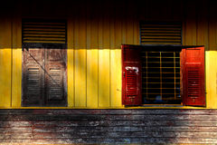 Vintage wooden wall with old style wooden windows in Chiang Mai, Royalty Free Stock Photo