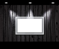 Vintage wooden wall with a spot illumination. Stock Photos