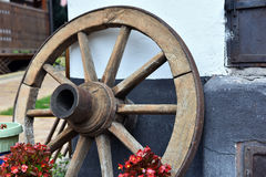 Vintage wooden wheel in a rural yard Royalty Free Stock Photos
