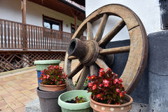 Vintage wooden wheel in a rural yard Royalty Free Stock Images