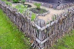 Vintage wooden wicker fence in old village. Vintage wooden aged wicker fence in old village Stock Photos