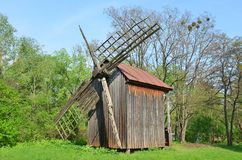 Vintage wooden windmill Stock Photos