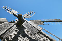 Vintage wooden windmill sails over clear blue sky Royalty Free Stock Images