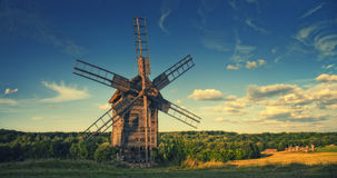 Vintage wooden windmill Stock Images