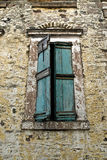 Vintage Wooden Window. An old greek stone building window Royalty Free Stock Image