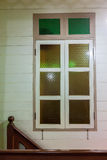 Vintage wooden window with colored glass Stock Images