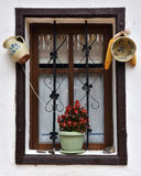 Vintage wooden window frame with hanged pottery. Vintage brown wooden window frame with hanged pottery Stock Photo