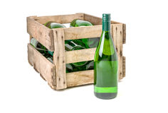 Vintage wooden wine crate filled white wine bottles. Vintage wooden wine crate filled with wine bottles stock photo
