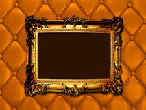 Vintage woodern frame on the leather backround Stock Image