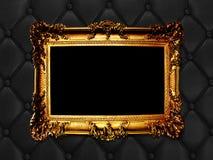 Vintage woodern frame on the leather backround Stock Images