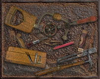 Vintage woodworking tools over rusty plate Royalty Free Stock Photos