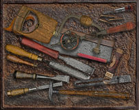 Vintage woodworking tools over rusty plate Royalty Free Stock Photo