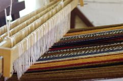 Vintage wool loom with a multi-colored rug royalty free stock photography