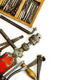 Vintage working tools ( drill and more) on white Stock Photo