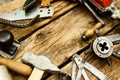 Vintage working tools (drill, saw, ruler and Royalty Free Stock Photography