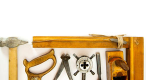 Vintage working tools ( hammer, saw and others) on Royalty Free Stock Images