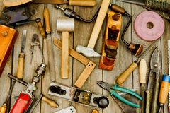 Vintage working tools on wooden background. Old working tools. Vintage working tools on wooden background Royalty Free Stock Photography