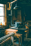 Vintage workshop full of old carpentery tools Royalty Free Stock Images