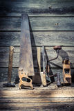 Vintage workshop full of old carpentery tools. On old wooden table Royalty Free Stock Photos
