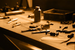 Vintage Worktable with Tools. View of an old worktable with many tools. Tinted in sepia for effect Stock Photography