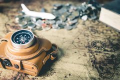 Vintage world Explorer with camera and compass focused Royalty Free Stock Images