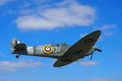 Vintage world war 2 Mark Vb spitfire in flight againt a blue sky with clouds Stock Images