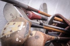 Vintage, worn out golf clubs. Retired from use stock photography