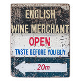Vintage worn wine merchant sign. Very old and worn vintage sign of an English wine merchant stock image