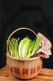 Vintage woven reed basket of organic, green vegetable Royalty Free Stock Image